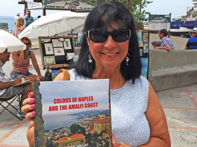 Margie Miklas with her new book